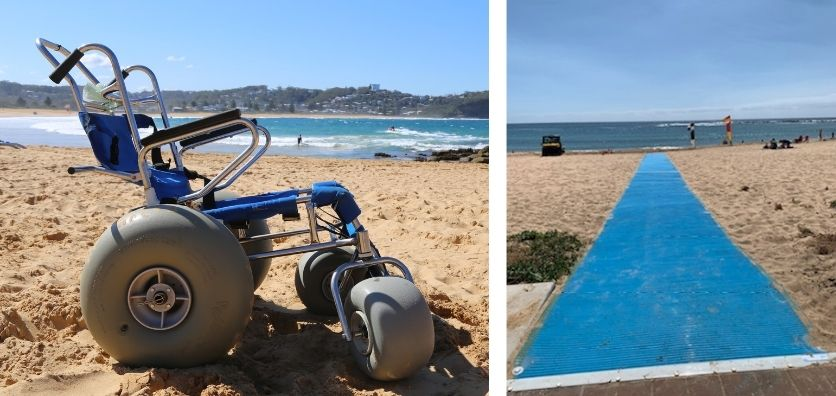 A beach wheelcahir on the sand at the beach, with the ocean in the background. The wheelchair has large grey wheels and a blue seat. A picture of blue beach matting rolled out across the sand at the beach.