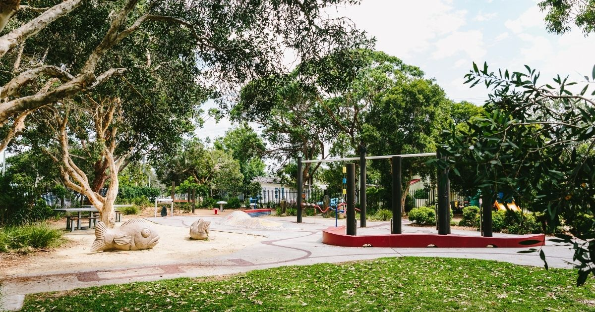 An inclusive playspace at Canton Beach.The playspace includes flat, wide pathways, climbing equipment and colourful walls.