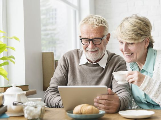 Mature man and woman reading iPad