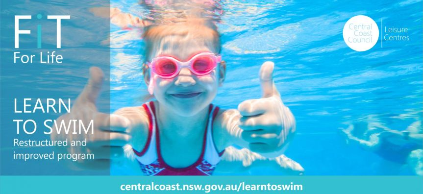 Little girl under water with thumbs up