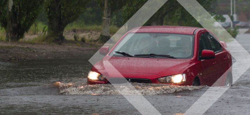 Image of car driving through water
