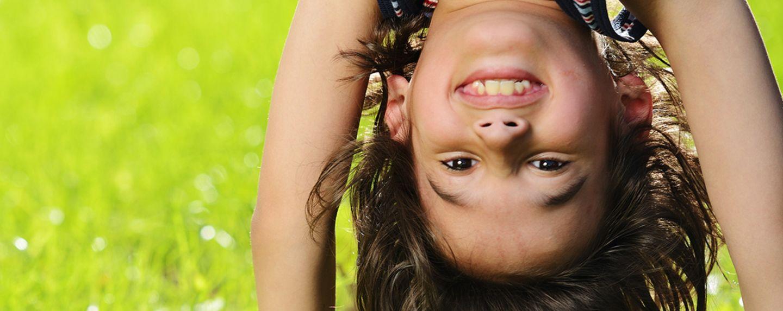 Girl hanging upside down